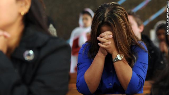 121227075645-pakistan-religion-christmas-praying-in-church-story-top
