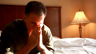 stock-footage-a-man-in-a-hotel-room-who-appears-to-be-troubled-or-anxious-about-something