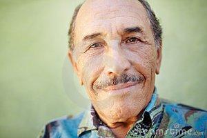 aged-latino-man-smiling-camera-20147222
